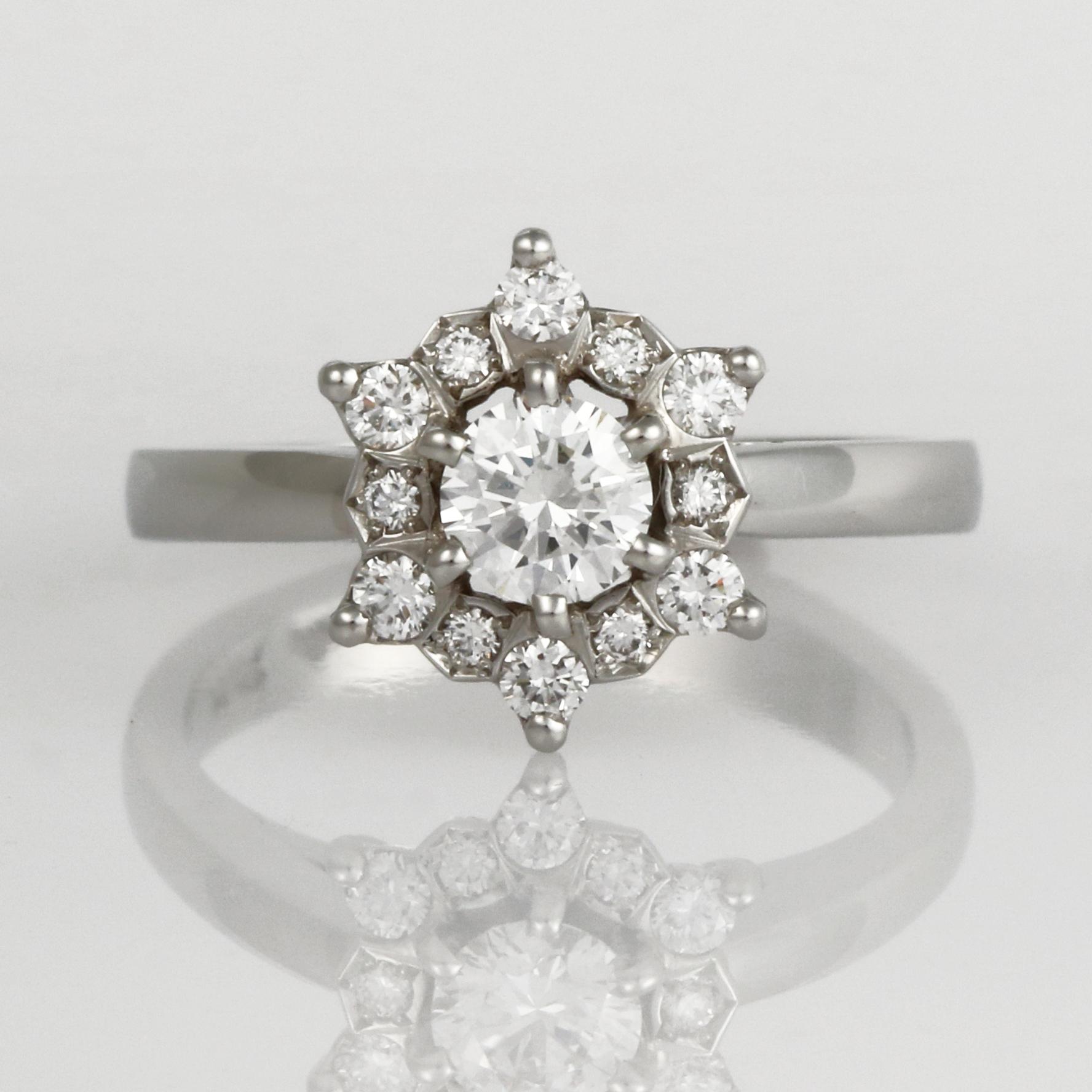 Handmade ladies platinum and diamond engagement ring