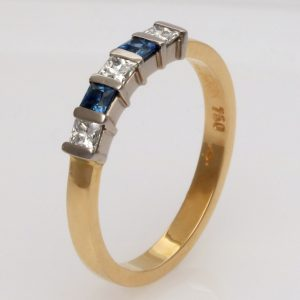 Ladies handmade 18ct, yellow and white gold,  Diamond and 'Ceylon' Sapphire Eternity ring