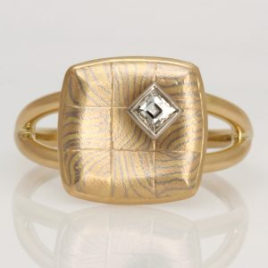 Handmade ladies, 18ct Yellow, Rose and White gold 'Mokume Gane', concave checkerboard setting, and 'Tycoon' Diamond ring