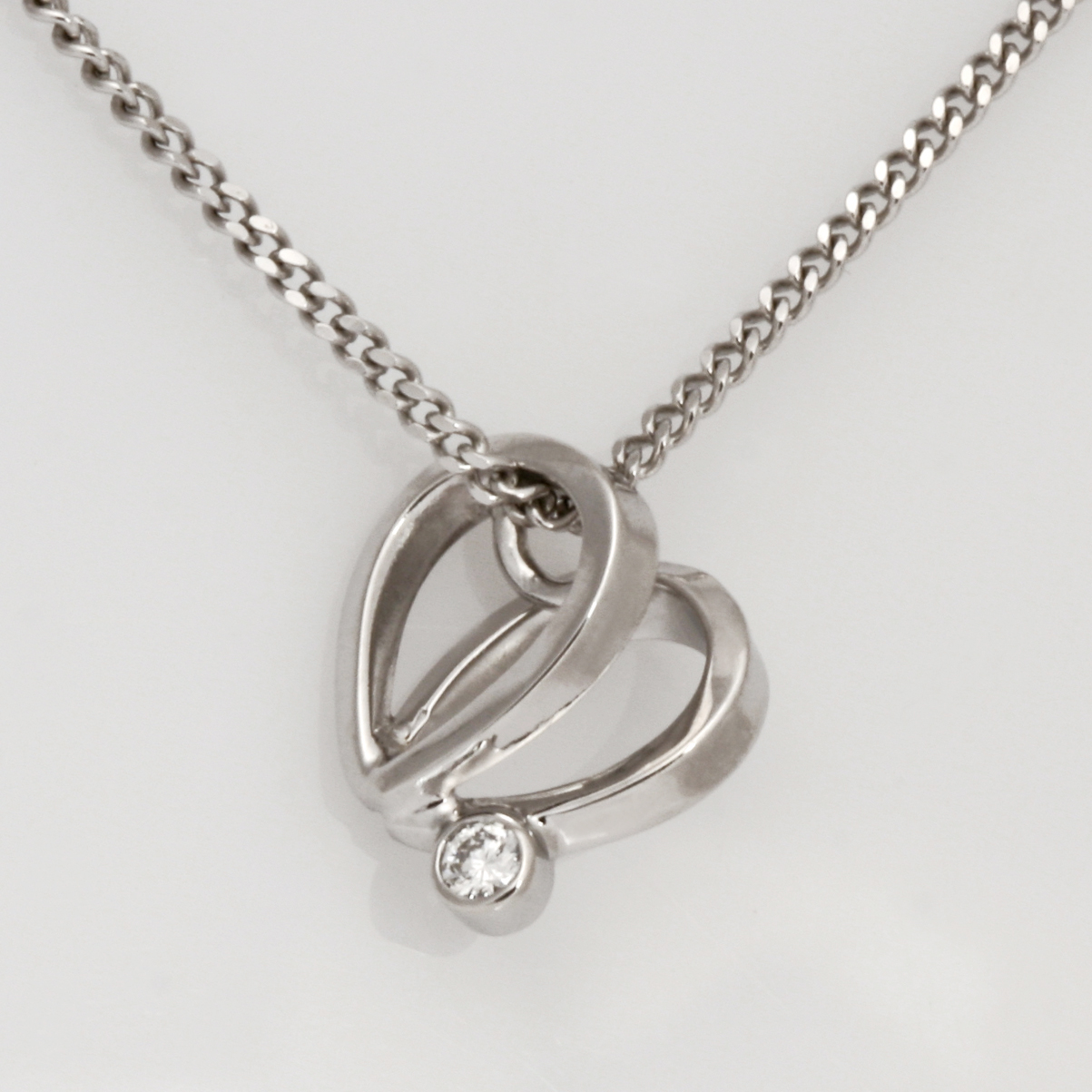 Ladies handmade 9ct white gold and Diamond heart pendant