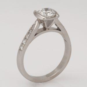 Handmade platinum cushion cut diamond engagement ring