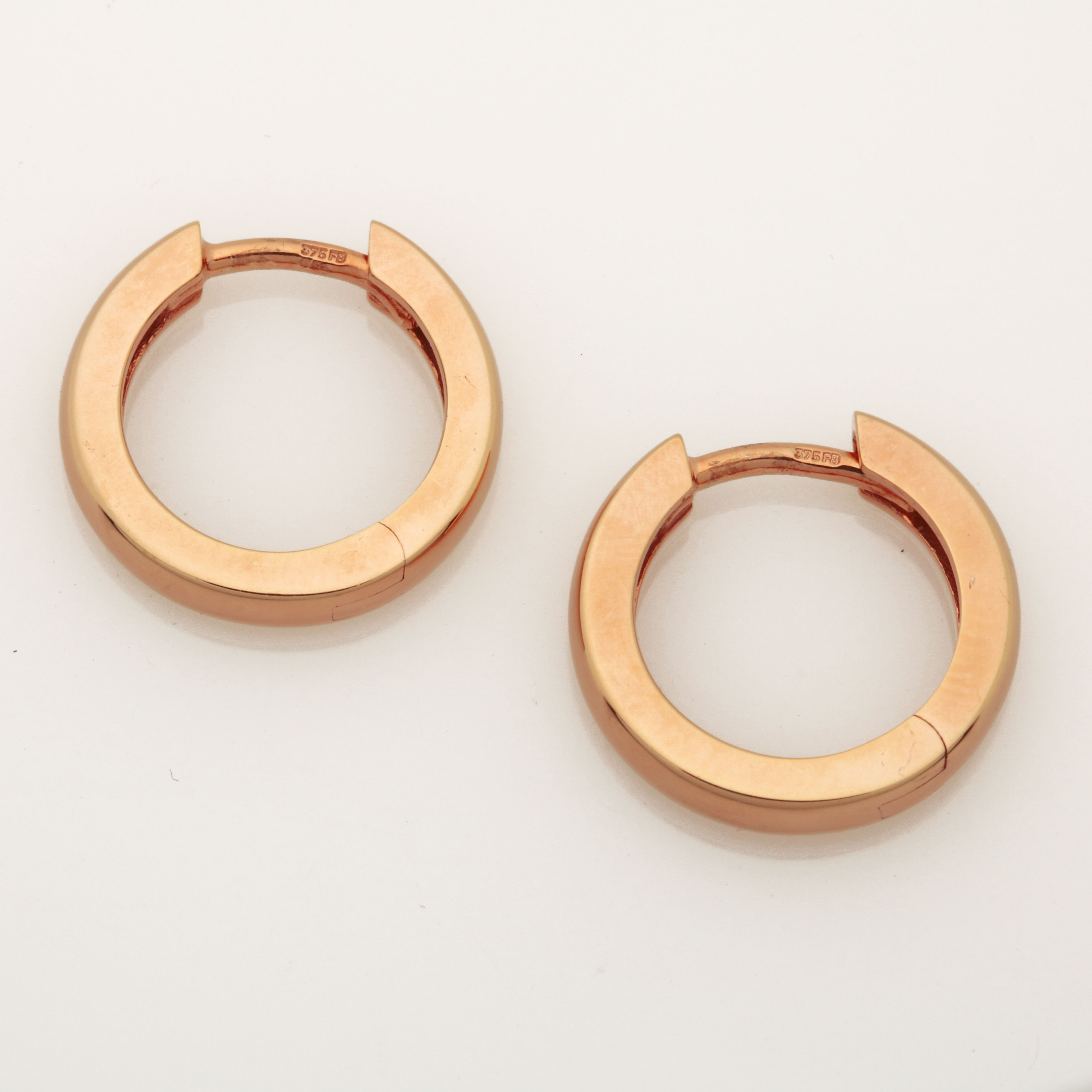 E0207 9ct Rose gold huggies earrings $340
