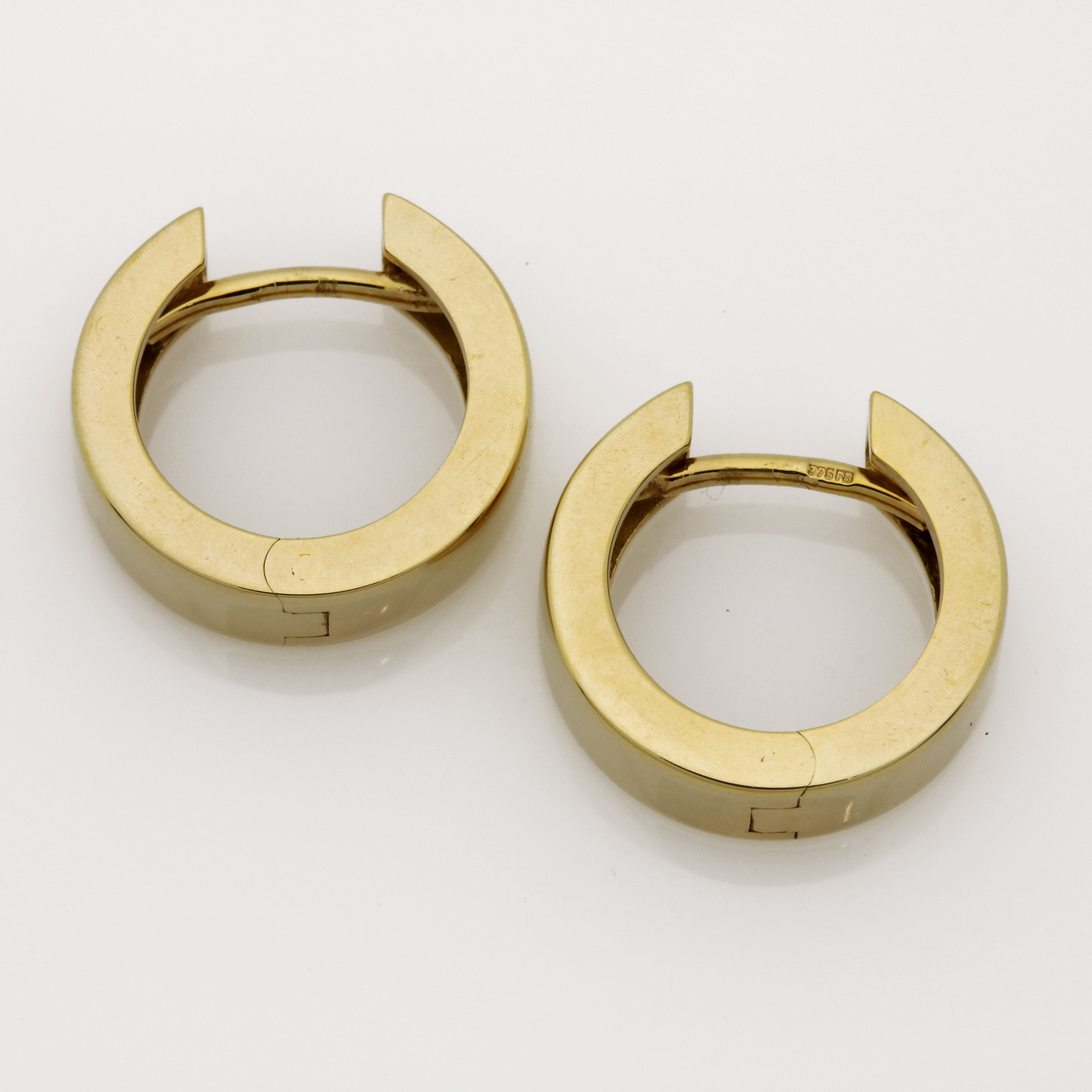 E0208 9ct Yellow gold huggies earrings $495