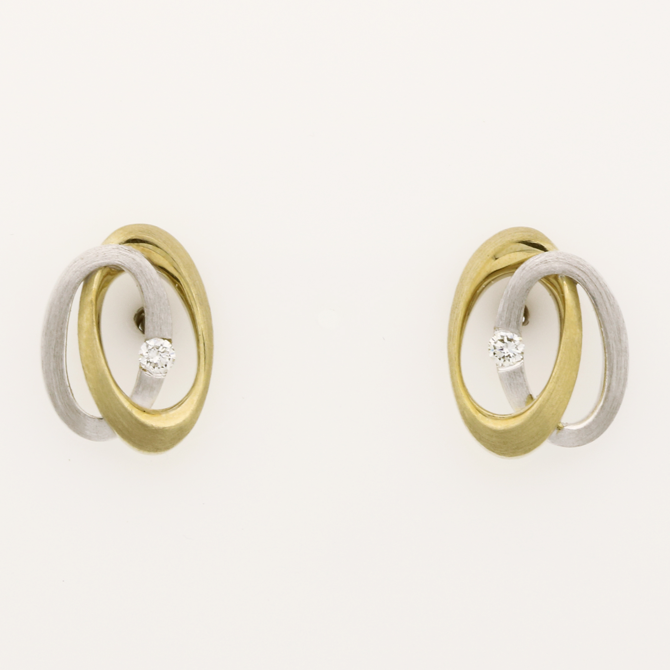 E0224 9ct white and yellow gold swirl diamond earrings $550