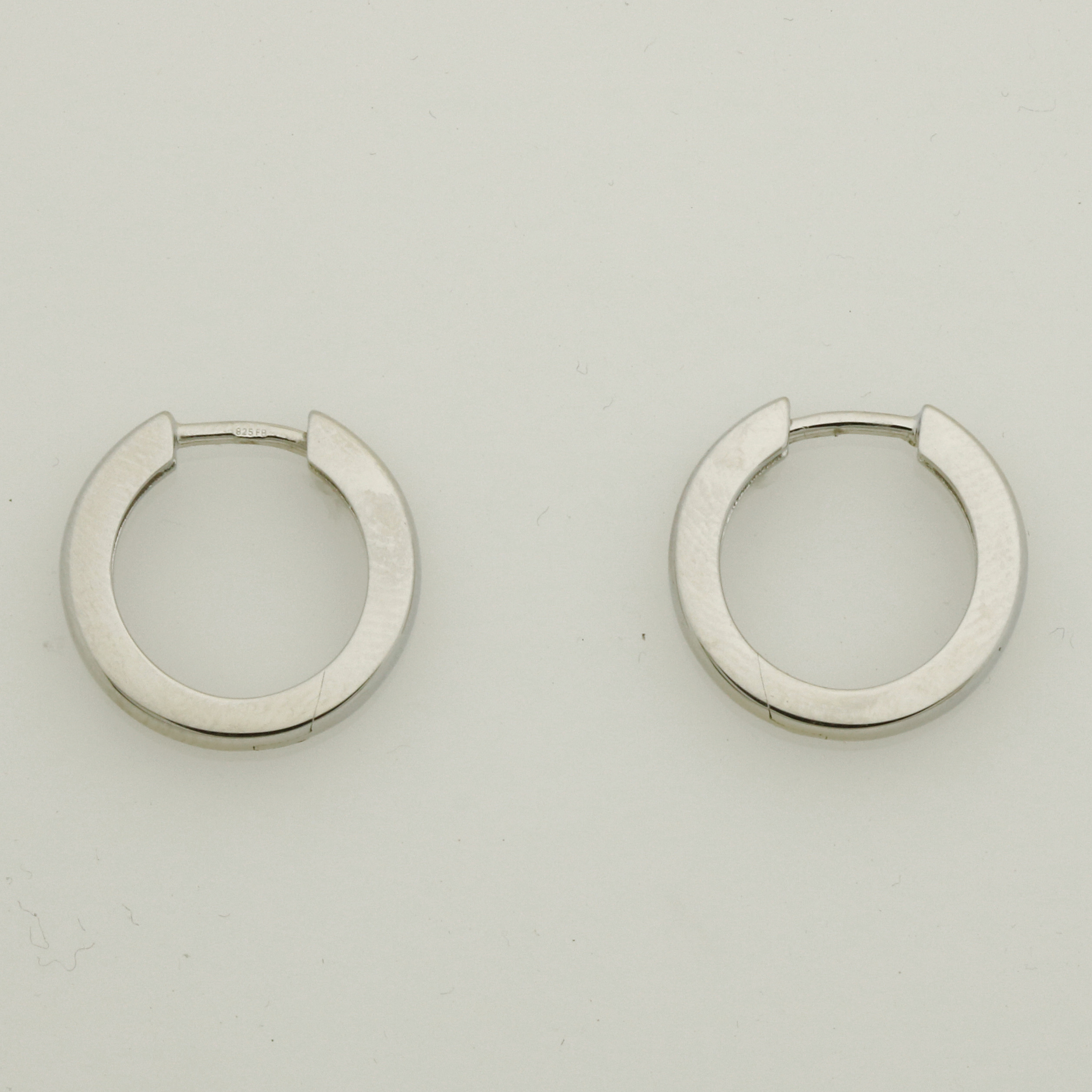 E0228 Sterling silver/rhodium plated huggies earring $160