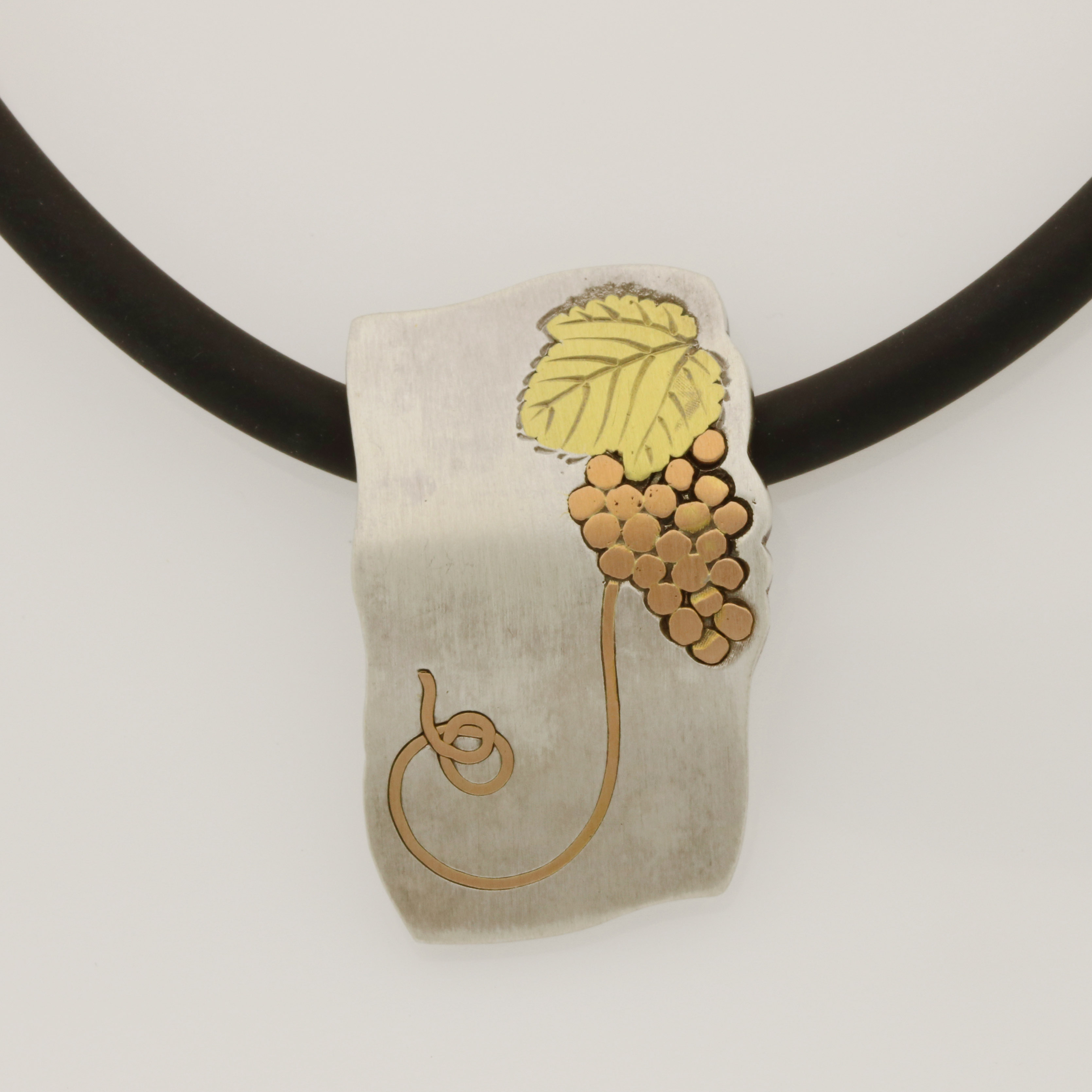 P119 Sterling silver 18ct rose and green gold grapevine pendant with CH009 black rubber necklet $600